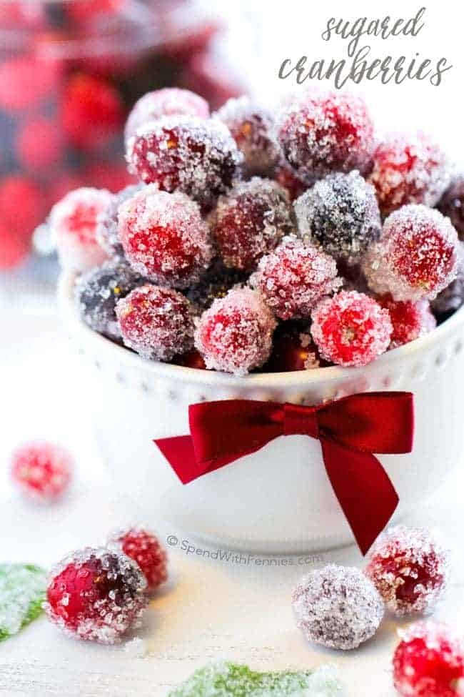 sugared cranberries in a white bowl with text