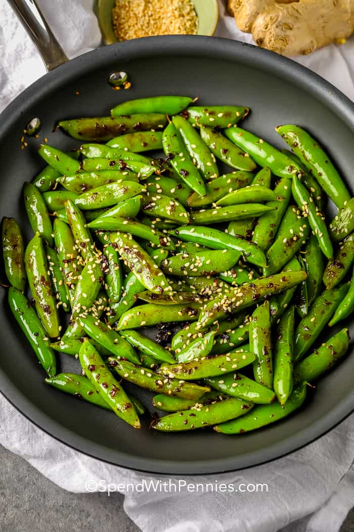 snap peas with soy and garlic in a frying pan