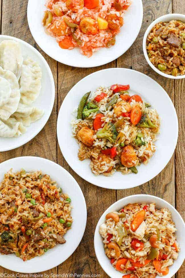 Chinese food in white bowls on a wood table