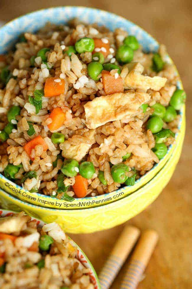 Homemade Fried Rice is the perfect meal on it's own or accompaniment to any Asian inspired meal! Fresh veggies, rice and lean protein seasoned with our favorite flavors.
