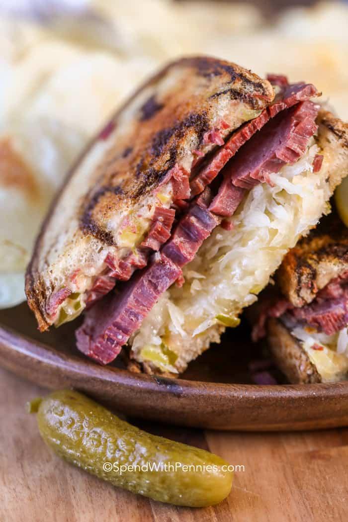 Reuben Sandwiches on a plate with sauerkraut