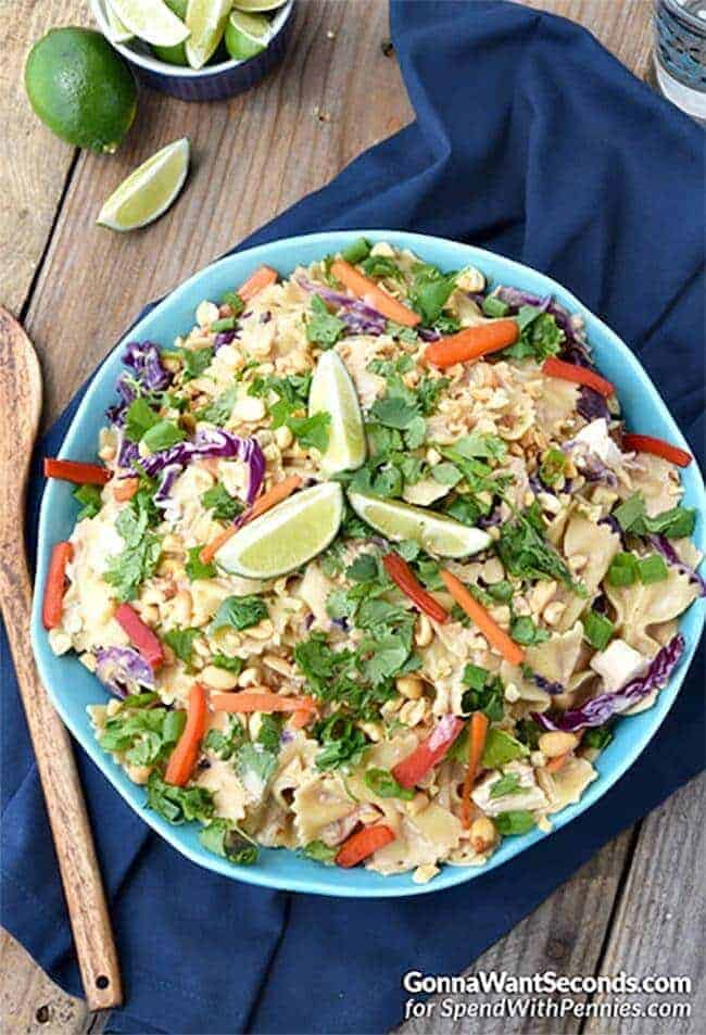 Creamy Peanut Thai Noodles is smothered in a Thai-flavored peanut butter cream sauce and loaded with chicken, red peppers, carrots & green onions for a great family meal. One of our family favorite recipes!