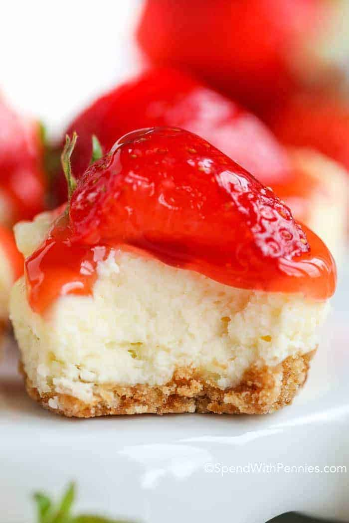 individual cheesecake with strawberry and vanilla wafer