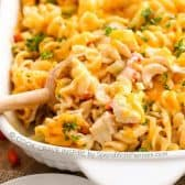 a casserole filled with Ranch Buffalo Pasta Bake loaded with pasta, chicken, and cheese in a creamy buffalo ranch sauce