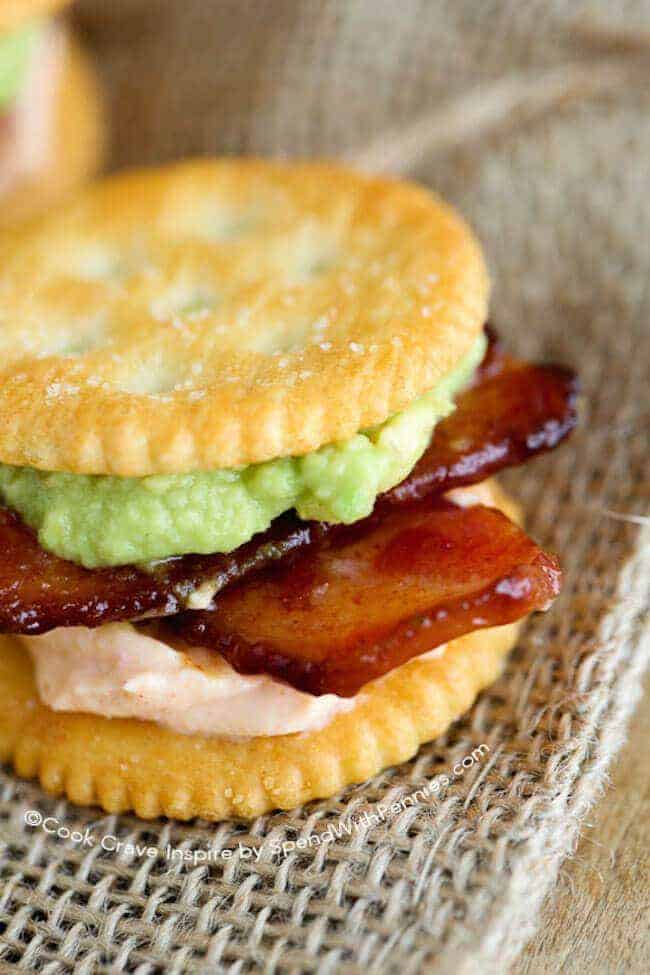 Sriracha Bacon Ritzwich!A quick and easy snack idea! These RITZwiches feature buttery Ritz crackers loaded with sriracha bacon and avocado for the perfect 2 bite snack!