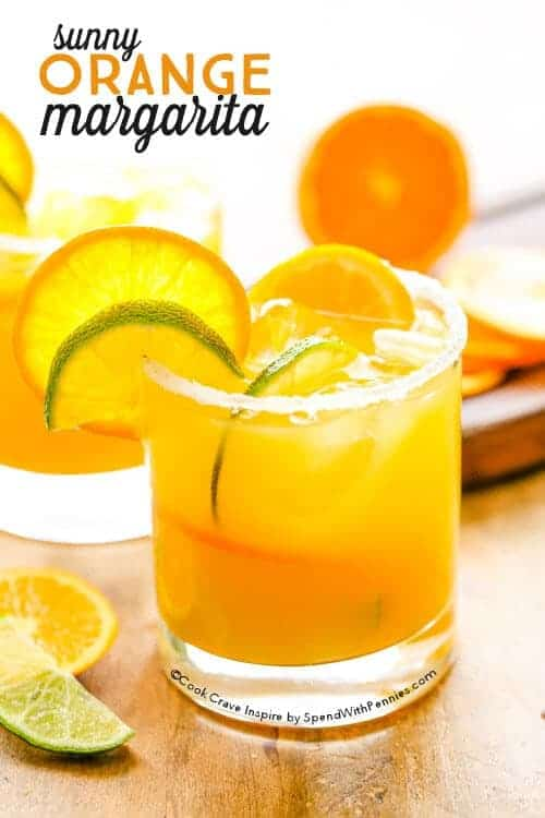 Orange Margarita in glass with orange slices