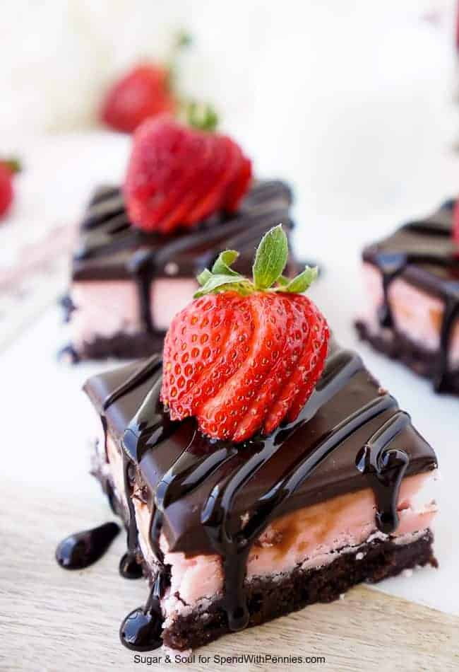 These Strawberry Layer Brownies are a sinfully sweet treat. They're made up of a base of fudge brownies, topped with a layer of strawberry creme candy and a layer of chocolate ganache.