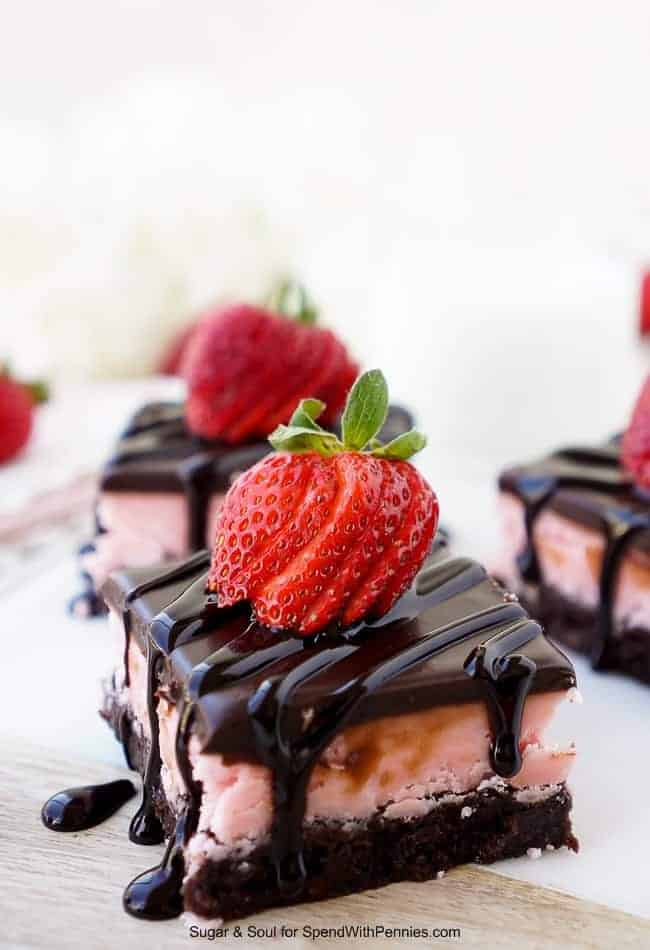 strawberry layer brownies with a fresh strawberry garnish