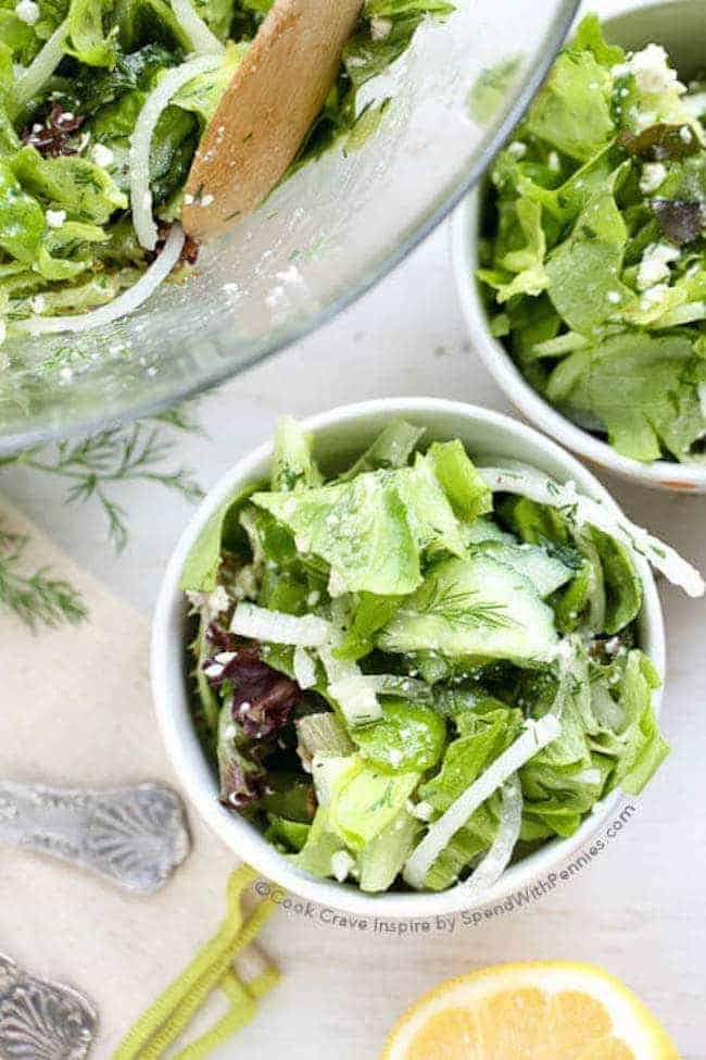 Cucumber Dill Salad with 2 Minute Lemon Vinaigrette! We eat this a couple of times every week! It's ready in minutes and the perfect side! Fresh dill, cucumber, sweet onion and tender leafy lettuce in a fast homemade lemon vinaigrette!