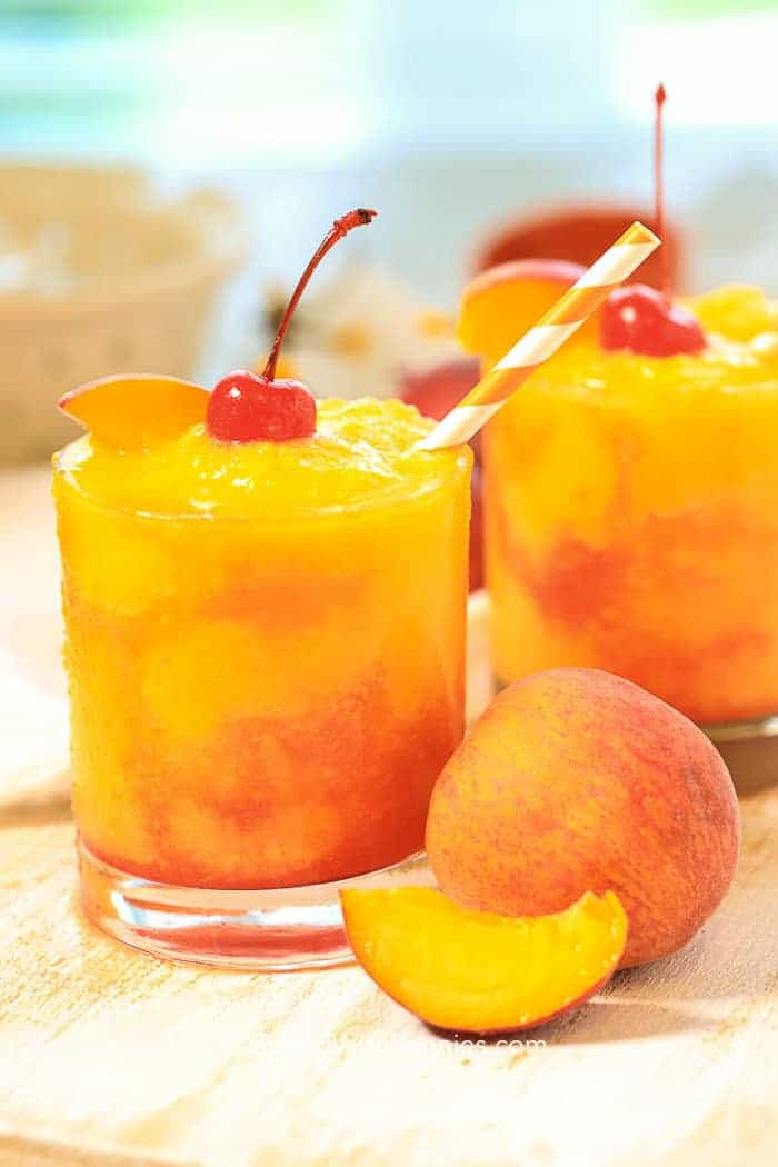 This slushy juicy Frozen Peach Champagne Cocktail takes just 5 minutes to prep. The fresh flavor of juicy ripe peaches combined with champagne creates the perfect slushy summer cocktail!