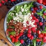Overhead shot of Fruit & Nut Spinach Salad on a cutting board