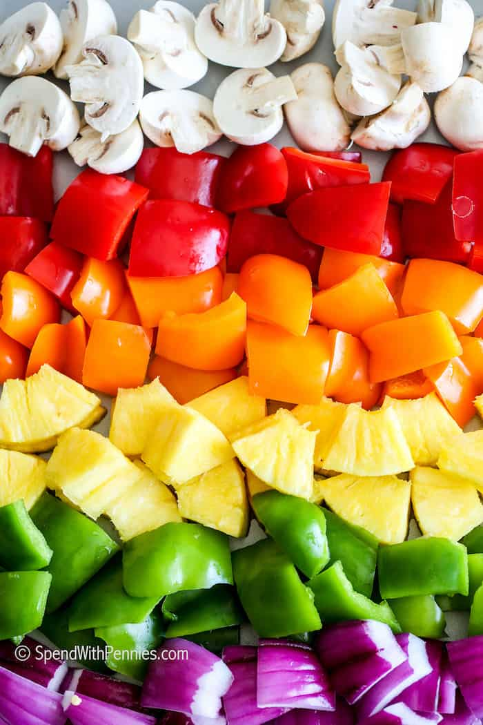 A rainbow of veggies on pan for chicken kebabs