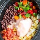 Overhead shot of chicken chili ingredients in a crockpot