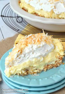 This Coconut Banana Cream Pie has the most luscious, velevety custard set in an amazing baked coconut crust.