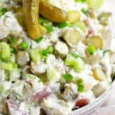Bowl of Dill Pickle Potato Salad with two small pickles on top