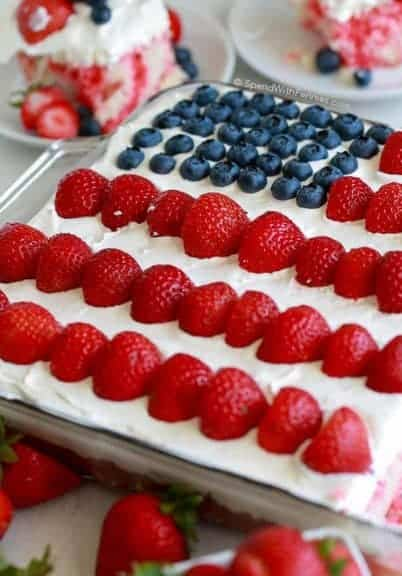 This Flag Cake topped with a no bake cheesecake is the perfect dessert for your 4th of July parties! The recipe comes together easily with your favorite white boxed cake mix (or your favorite homemade white cake) and the addition of a few simple ingredients. The cheesecake topping on this cake will have everyone asking for the recipe. It's rich and light at the same time without being overly sweet!