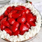 Overhead shot of Strawberry Cheesecake Pie with a small bowl of strawberries next to it