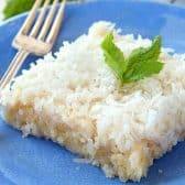 Coconut Sheet Cake~This cake is a coconut lovers dream come true. Super moist, tender coconut cake with a thick layer of frosting topped with more coconut.