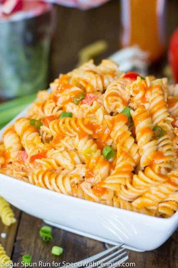 White bowl full of buffalo chicken pasta salad