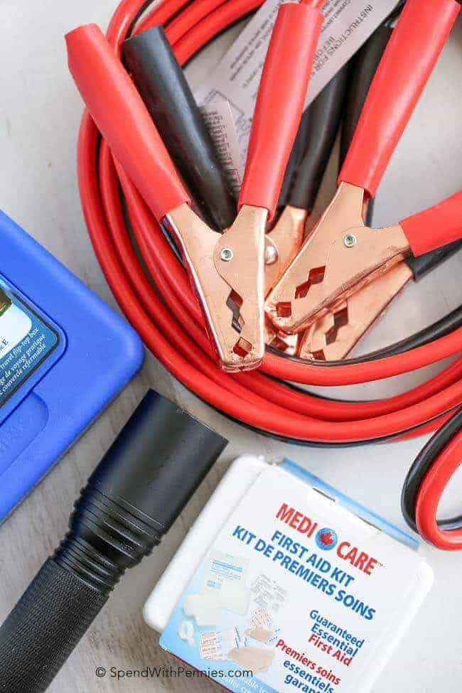 Jumper cables, small first aid kit and flashlight