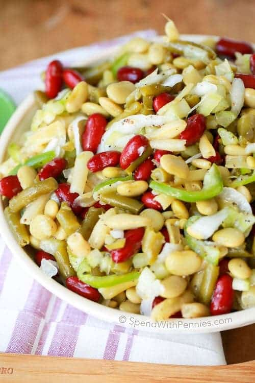 This Old Fashioned Bean Salad has been a family staple for years. 4 kinds of beans and a hint of white onion all dressed in a sweet vinaigrette dressing. This is the perfect make ahead side salad for any get together or BBQ!