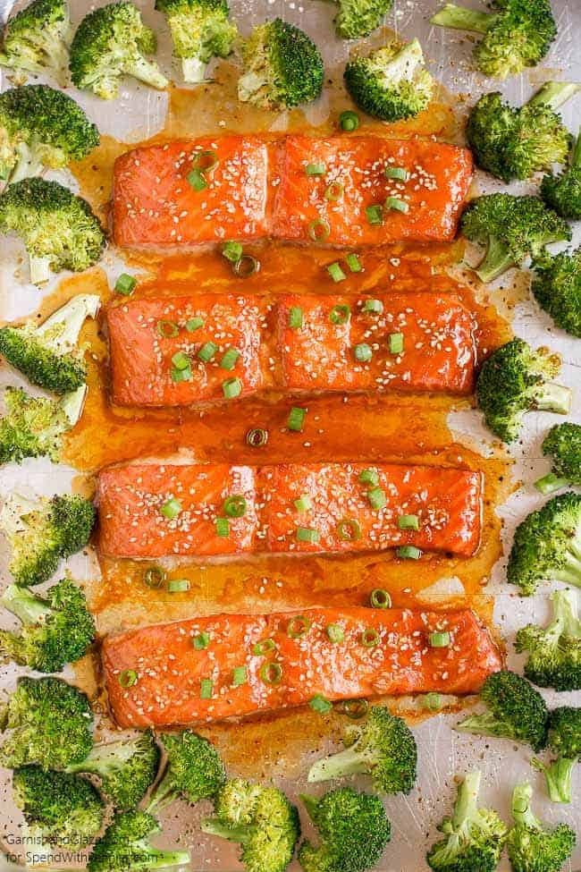 overhead shot of One Pan Sesame Ginger Salmon & Broccoli with green onion garnish on a sheet pan