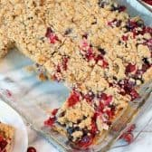 Sour Cream Cranberry Bars. These easy squares combine a buttery crumbly oat base with the sweet and tangy flavor of lemon kissed fresh cranberries.