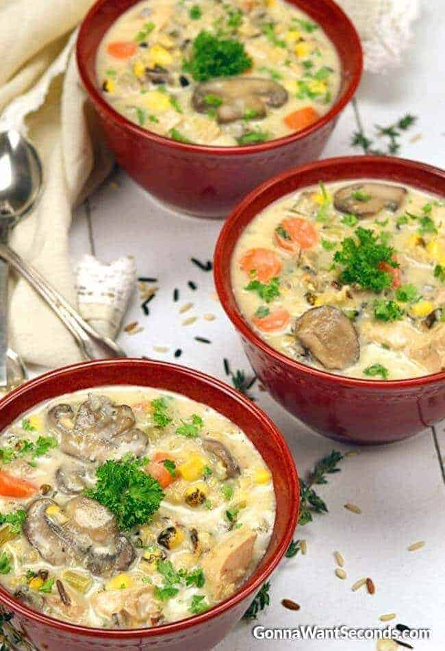 Creamy Chicken and Wild Rice Soup in bowls with a spoon