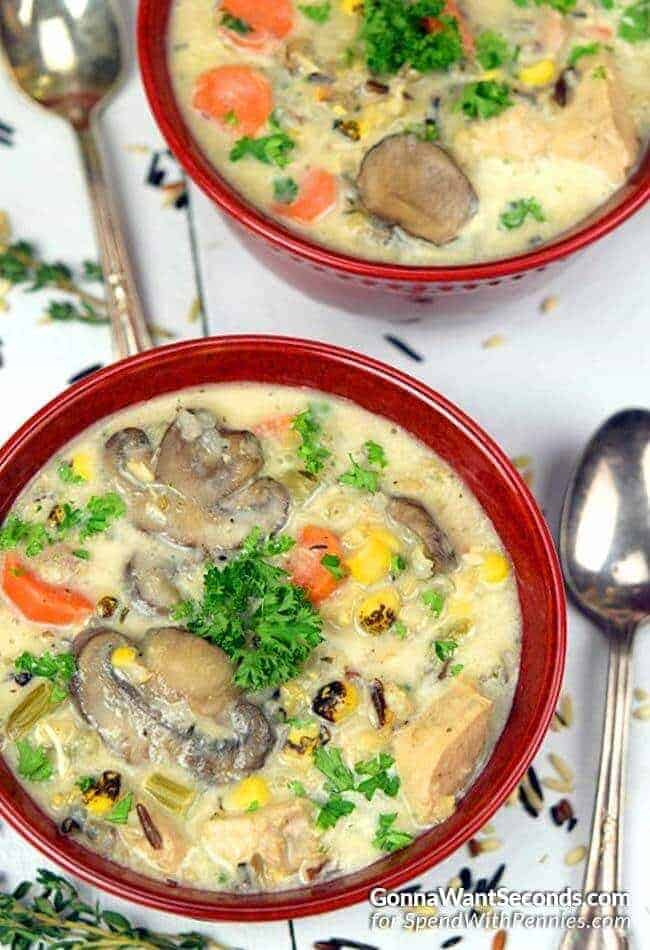 Creamy Chicken and Wild Rice Soup in red bowls