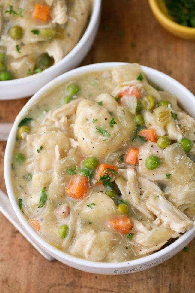 Easy Crock Pot Chicken & Dumplings. Tender chicken breasts cook in the slow cooker in a rich creamy sauce. Shortcut dumplings are added in for a delicious comforting meal with very little effort. This is one family recipe everyone will agree on.