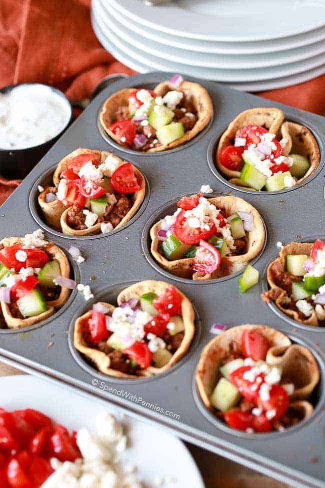 Greek salad cups in a muffin tin
