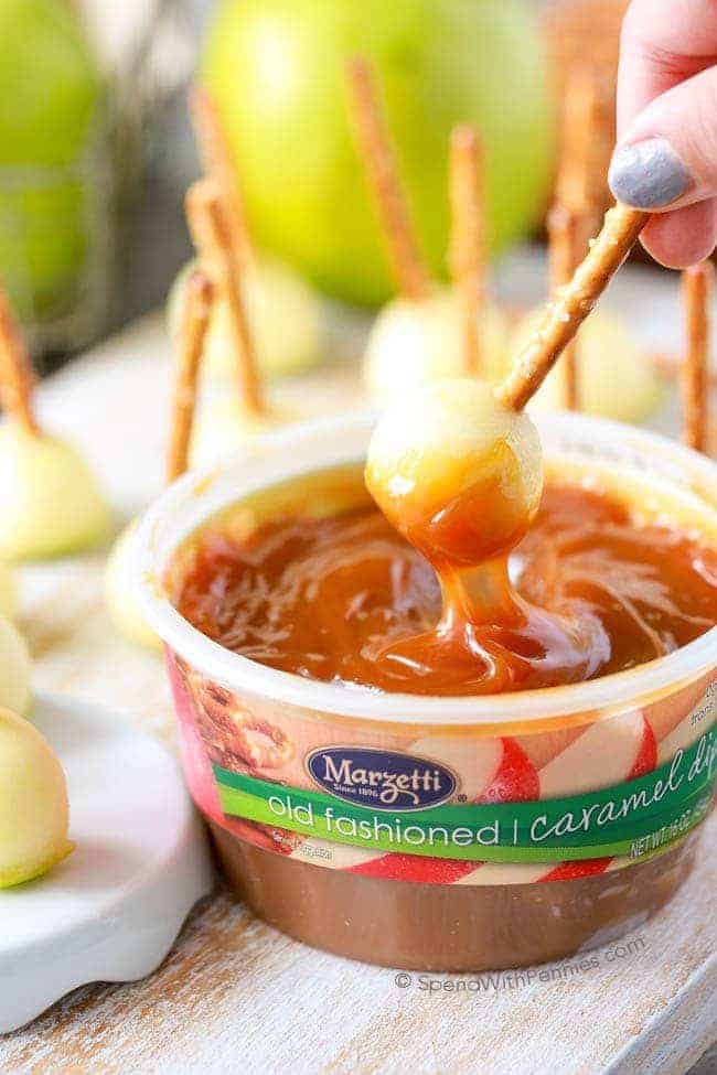 caramel sauce with apples being dipped