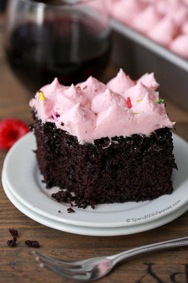 Red Wine Cake is one of those desserts that is almost too good to be true! It combines a scrumptious moist chocolate cake and gives it a hug with sweet red wine. The raspberry buttercream icing takes the cake to a whole new level of decadence that you won't want to miss!