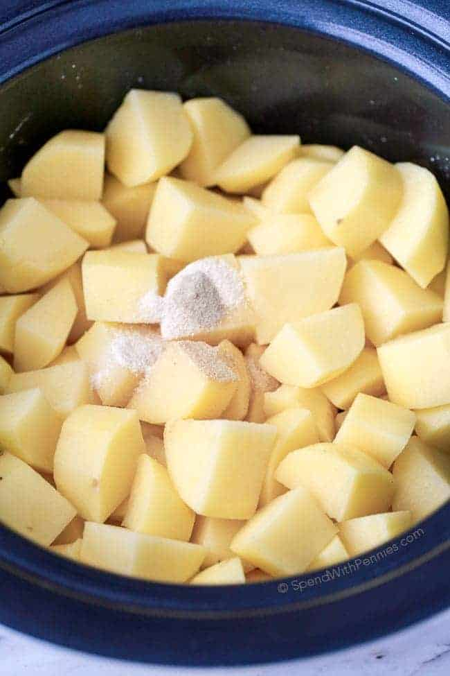 Uncooked Potatoes with seasonings in the slow cooker