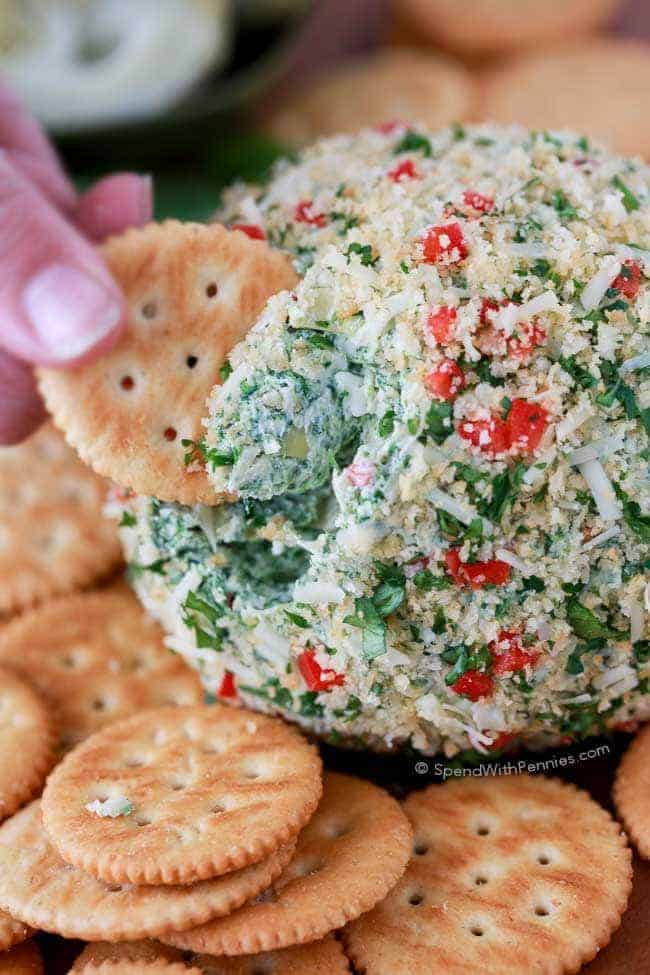 This easy Spinach Artichoke Cheese Ball is rich and creamy, loaded with cheesy goodness. This is perfect as a game day or holiday appetizer or snack.