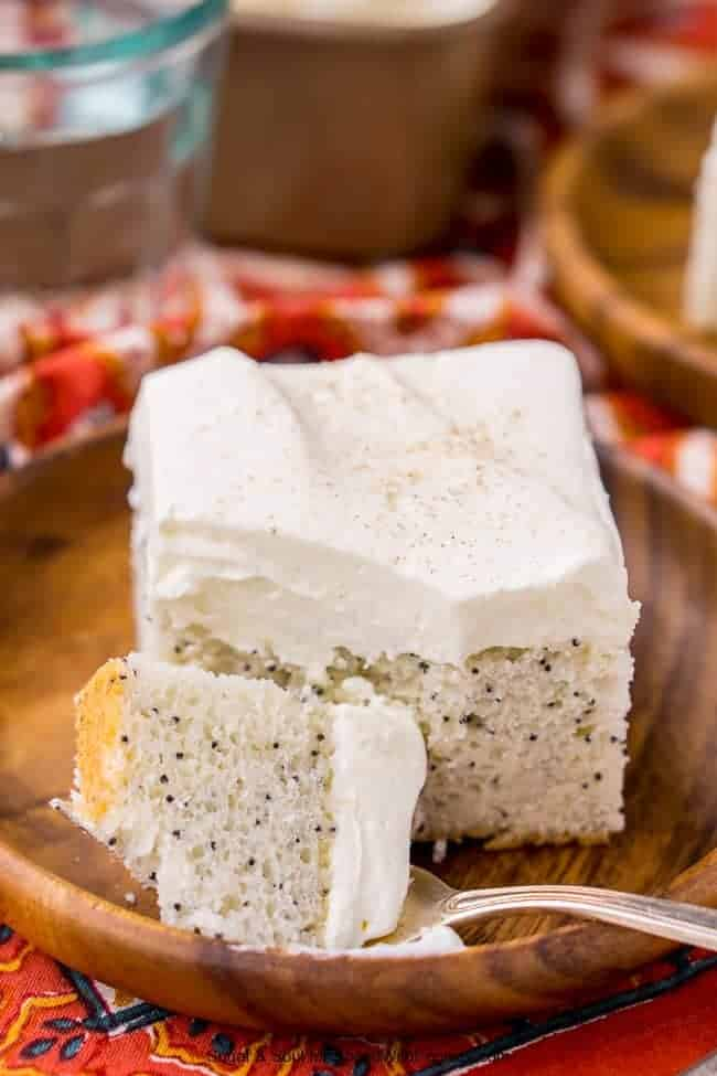 This Almond Poppyseed Sheet Cake is made with simple, yet bold flavors - a dense almond cake loaded with poppyseeds and topped with a whipped vanilla frosting. A cozy and easy sheet cake that belongs on every dessert table.