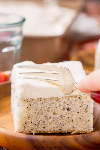 Almond Poppyseed Sheet Cake with a fork