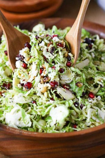 brussels sprout salad with cranberries and feta being served