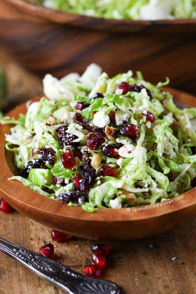 Brussels Sprout Salad with apples, feta cheese, cranberries, pomegranate arils and walnuts.
