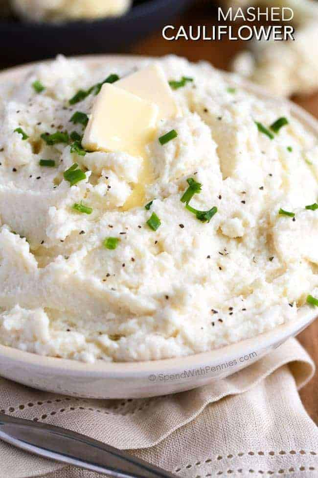 "Mashed Cauliflower ""Potatoes"". This mashed cauliflower recipe is a deliciously satisfying side, low in carbs and big on flavor! The perfect way to enjoy cauliflower and a delicious substitute for mashed potatoes!"