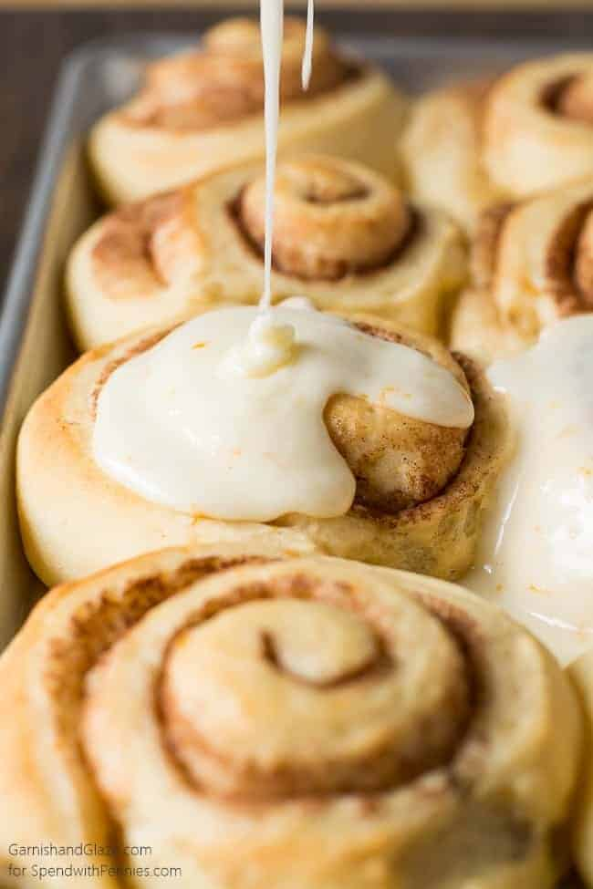 Orange Cinnamon Rolls are the perfect way to celebrate the holidays with your family this year. A light and fluffy homemade orange infused cinnamon roll smothered in an amazing orange glaze.