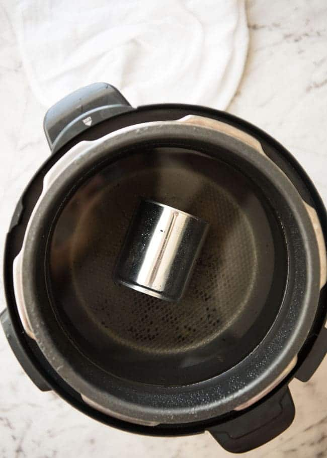 a can placed in a slow cooker