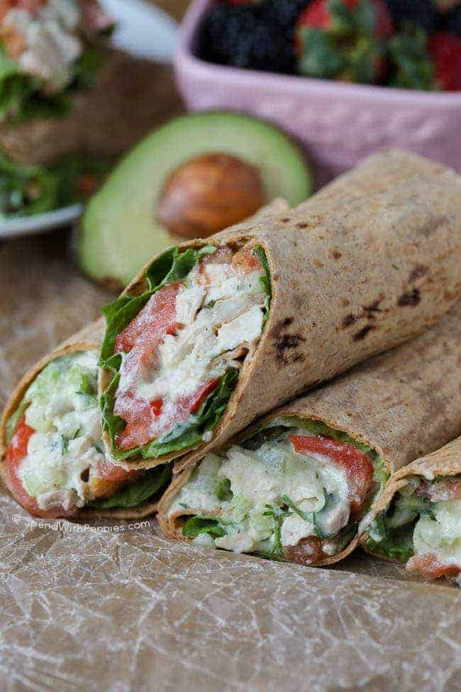 Avocado Ranch Chicken Salad Wrap stacked on parchment paper