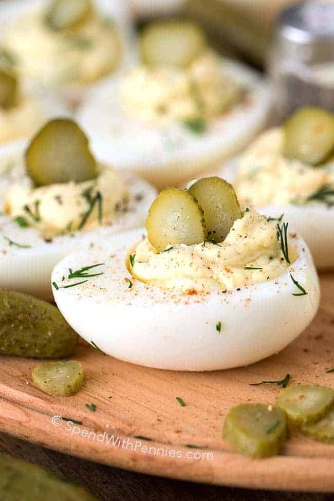 close up of delived eggs with pickle and dill