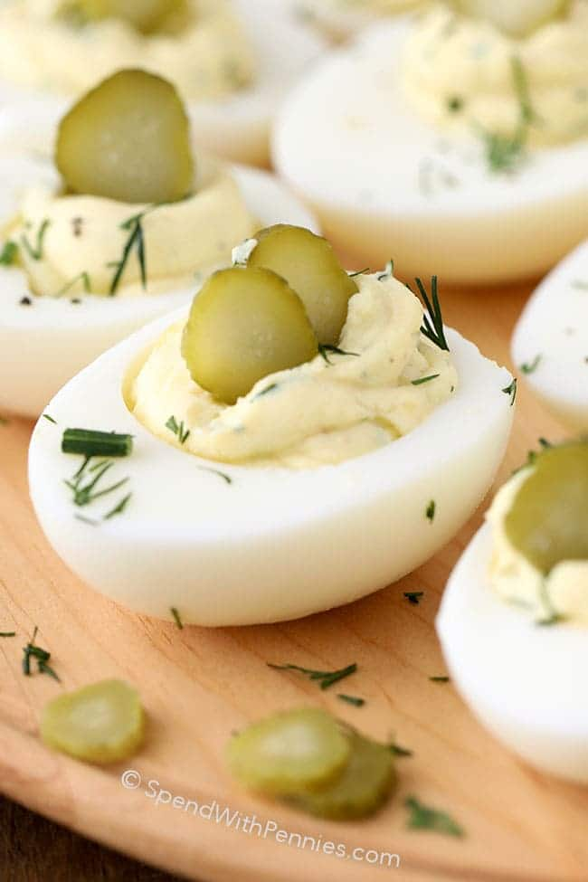 close up of Dill Pickle Deviled Eggs garnished with pickles and dill