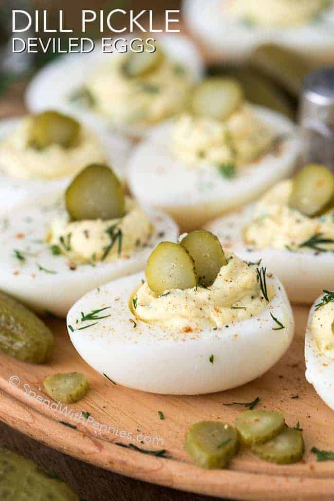 a tray of Dill Pickle Deviled Eggs garnished with pickle slices