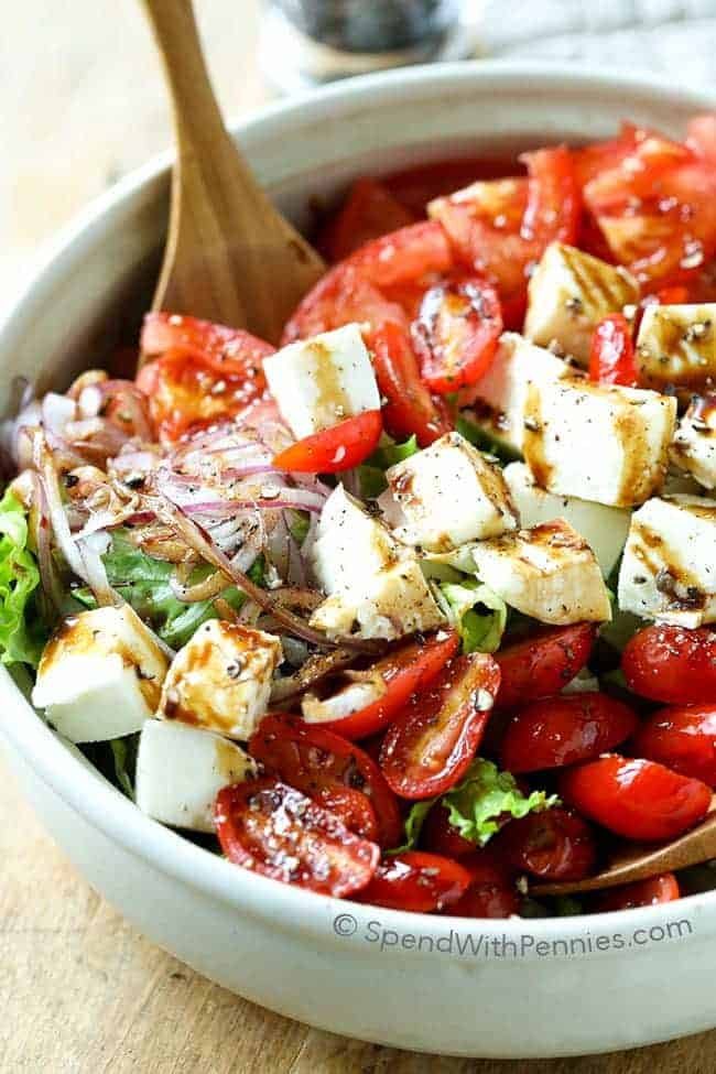mixing up Tomato Mozzarella Salad