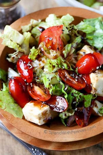 overhead view of Tomato Mozzarella Salad in a wood bowl
