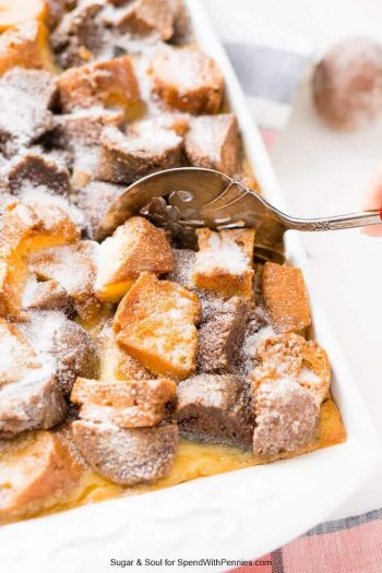 dishing up cake donut bread pudding from the baking dish