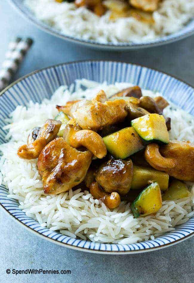A bowl of cashew chicken stirfry over rice